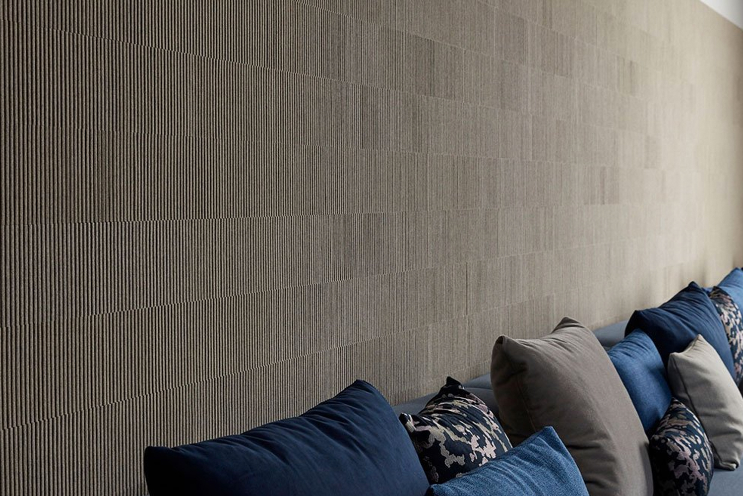 Just like its name, Ribsy wallcovering has a deep ribbed texture created with thick wool felt strips oriented on edge in alternating heights.