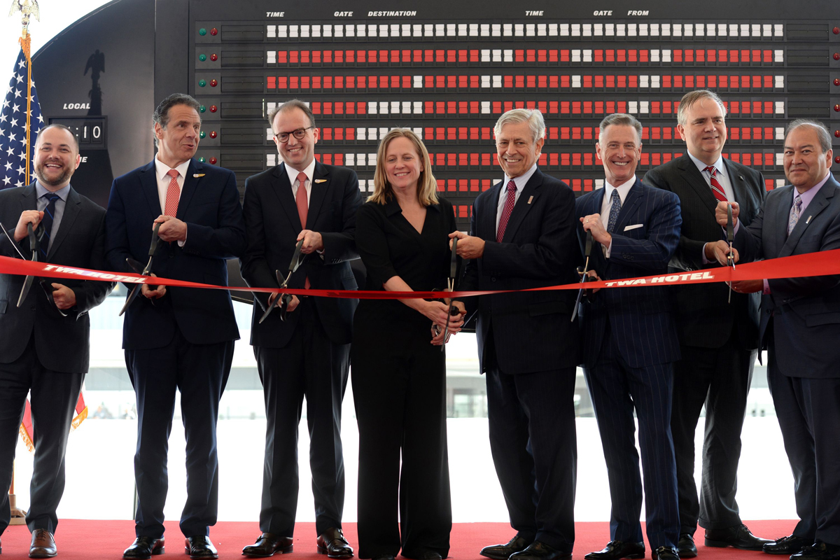 From left: City Council Speaker Corey Johnson; New York Governor Andrew M. Cuomo; Tyler Morse, CEO and managing partner of MCR and Morse Development; Queens Borough President Melinda Katz; Rick Cotton, executive director of the Port Authority of New York and New Jersey; Peter Ward, president of the New York Hotel & Motel Trades Council; Robin Hayes, CEO, JetBlue; Kevin J. O'Toole, chairman of the Port Authority of New York and New Jersey at the opening. (TWA Hotel)