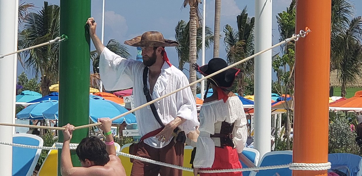 "The Adventure Pool, with ""Captain Jack"" shouting encouragement to young cruisers // Photo copyright by Susan J. Young"