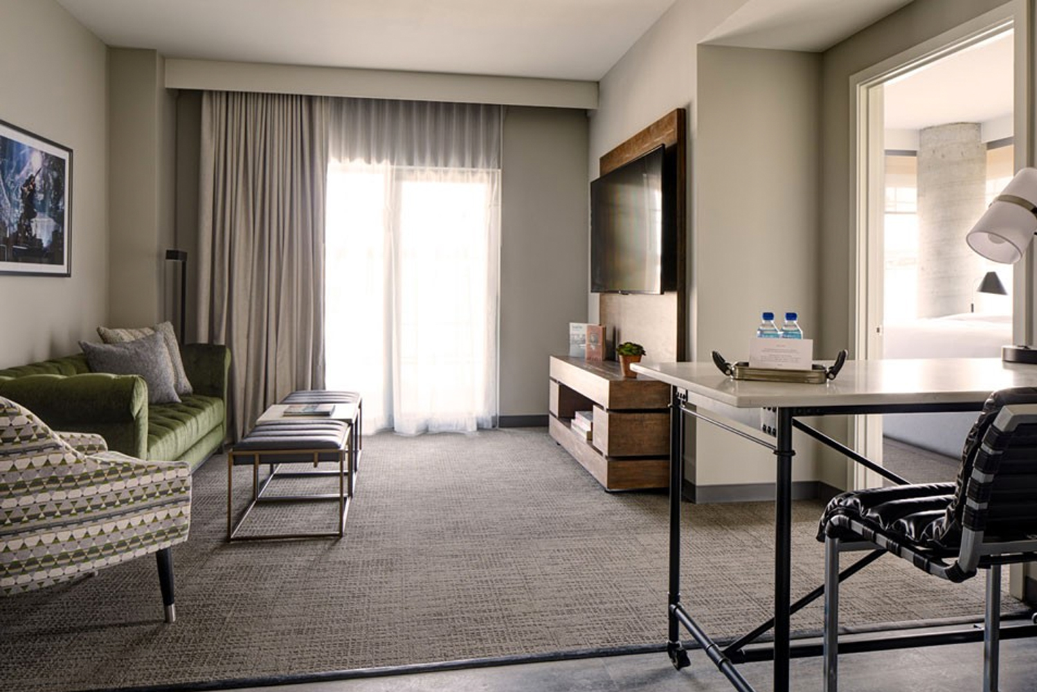 In-room amenities include: a work space, laptop safe, mini-refrigerator, flat-screen TV, device charging, alarm clock and radio.