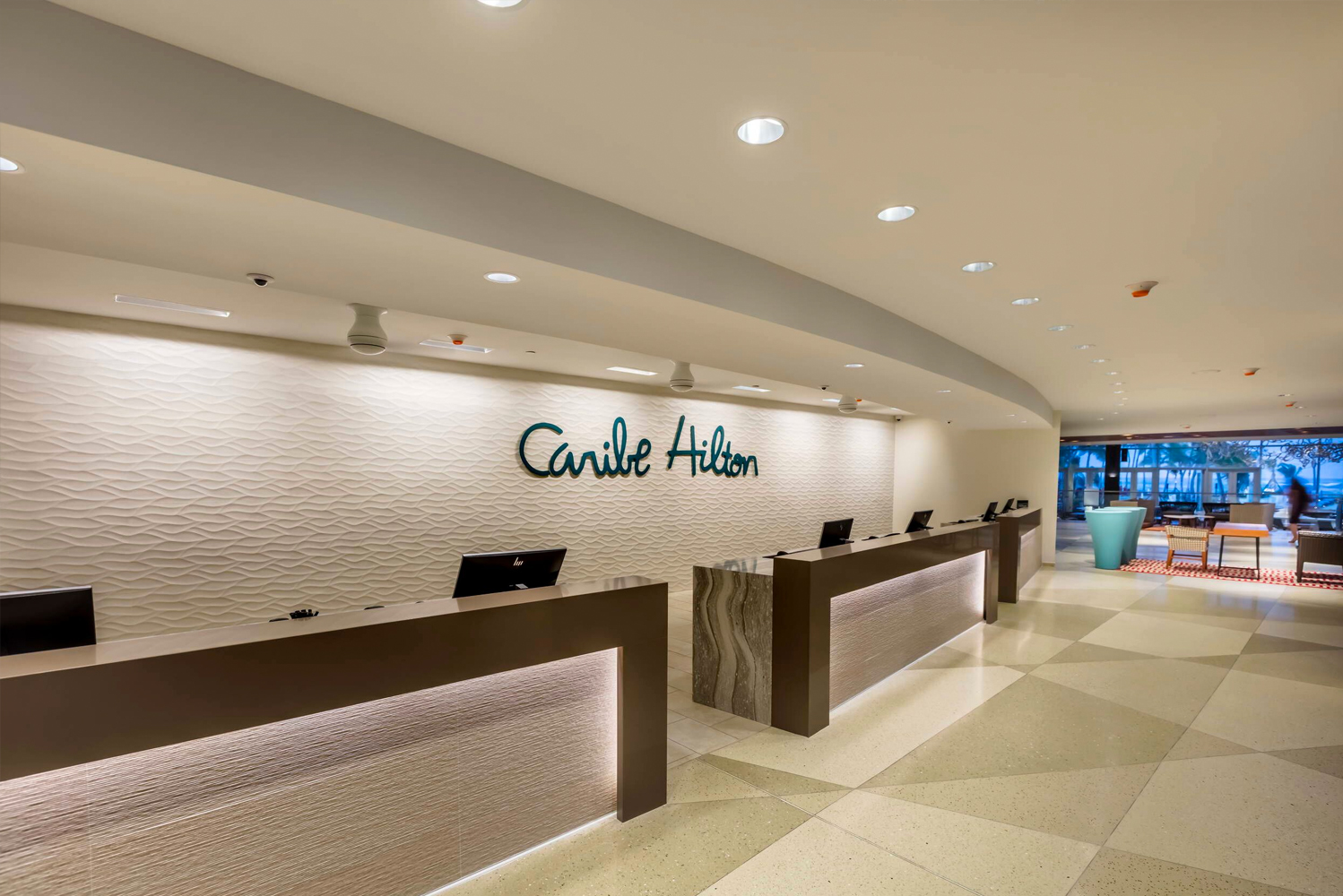 The Caribe Hilton sits beachfront on a peninsula made up of 17 acres of tropical gardens.