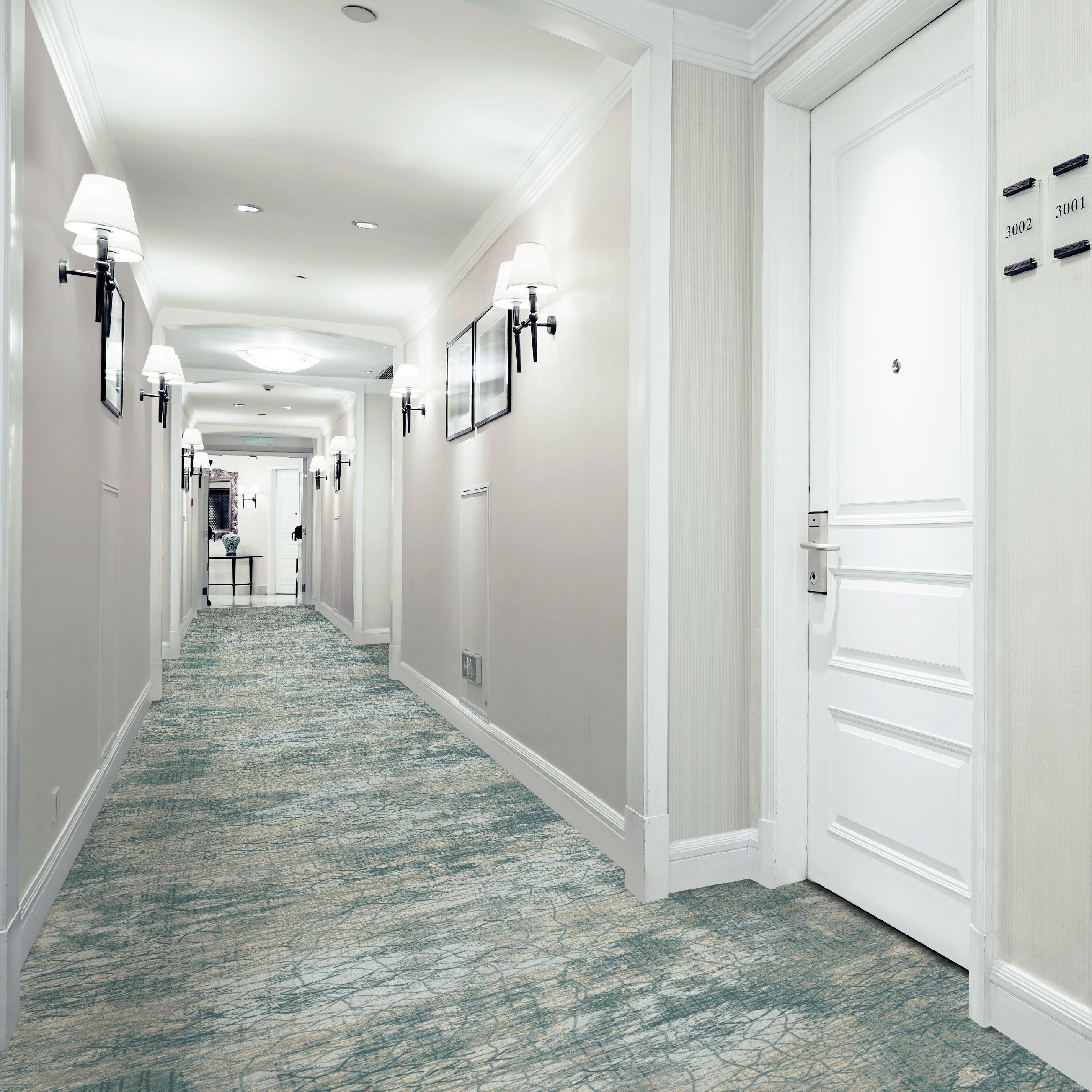 """Most of the time, guestrooms are a simpler coordinate to the hallway, either wall to wall or an area rug on top of [luxury vinyl tile] in a wood finish,"" said Lisa Herreth, creative director for Encore Hospitality Carpet. ""The corridors tend to have more interesting design elements and larger scale patterns."""