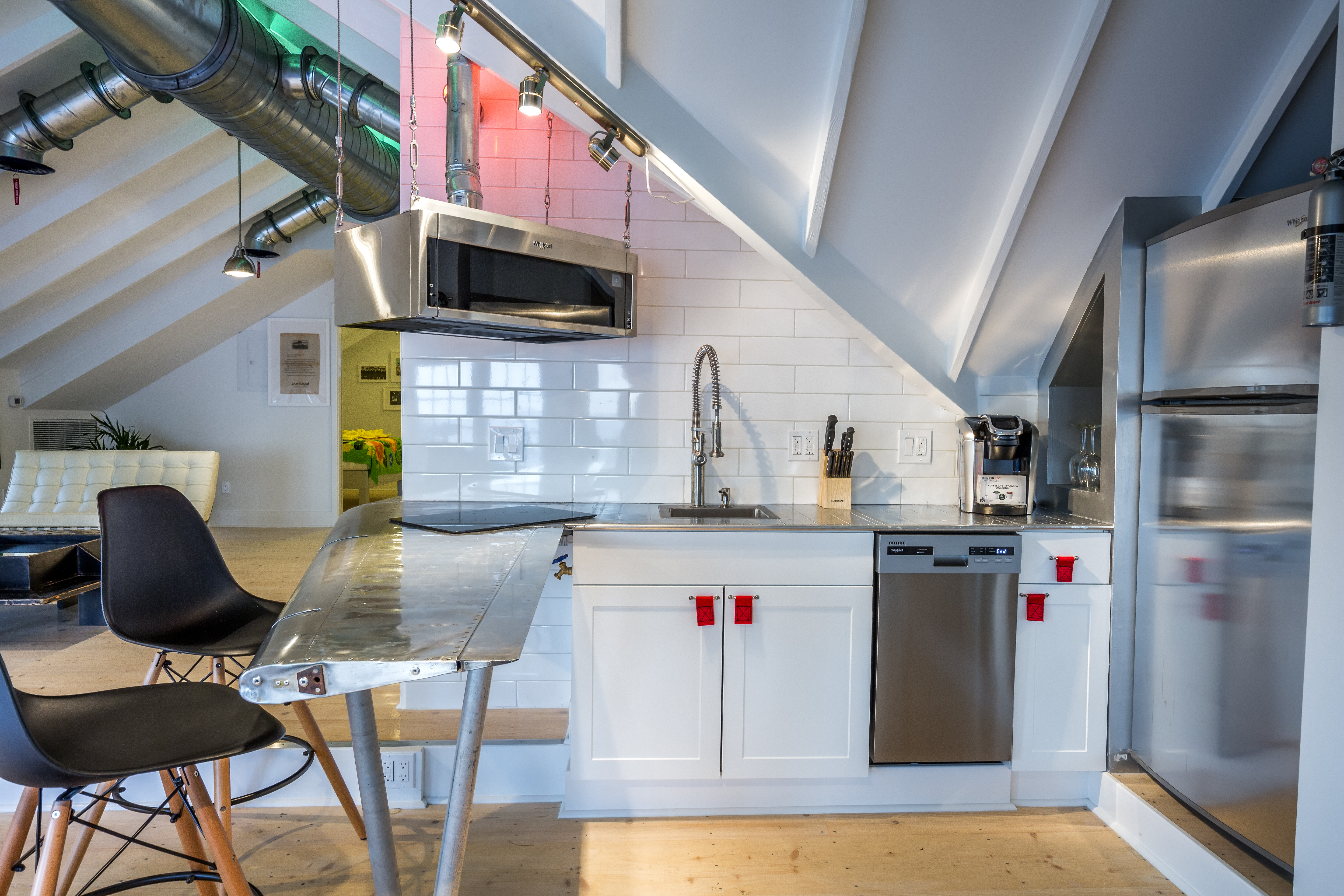 The bar/kitchen counter is made from an early aluminum plane's wing tip.