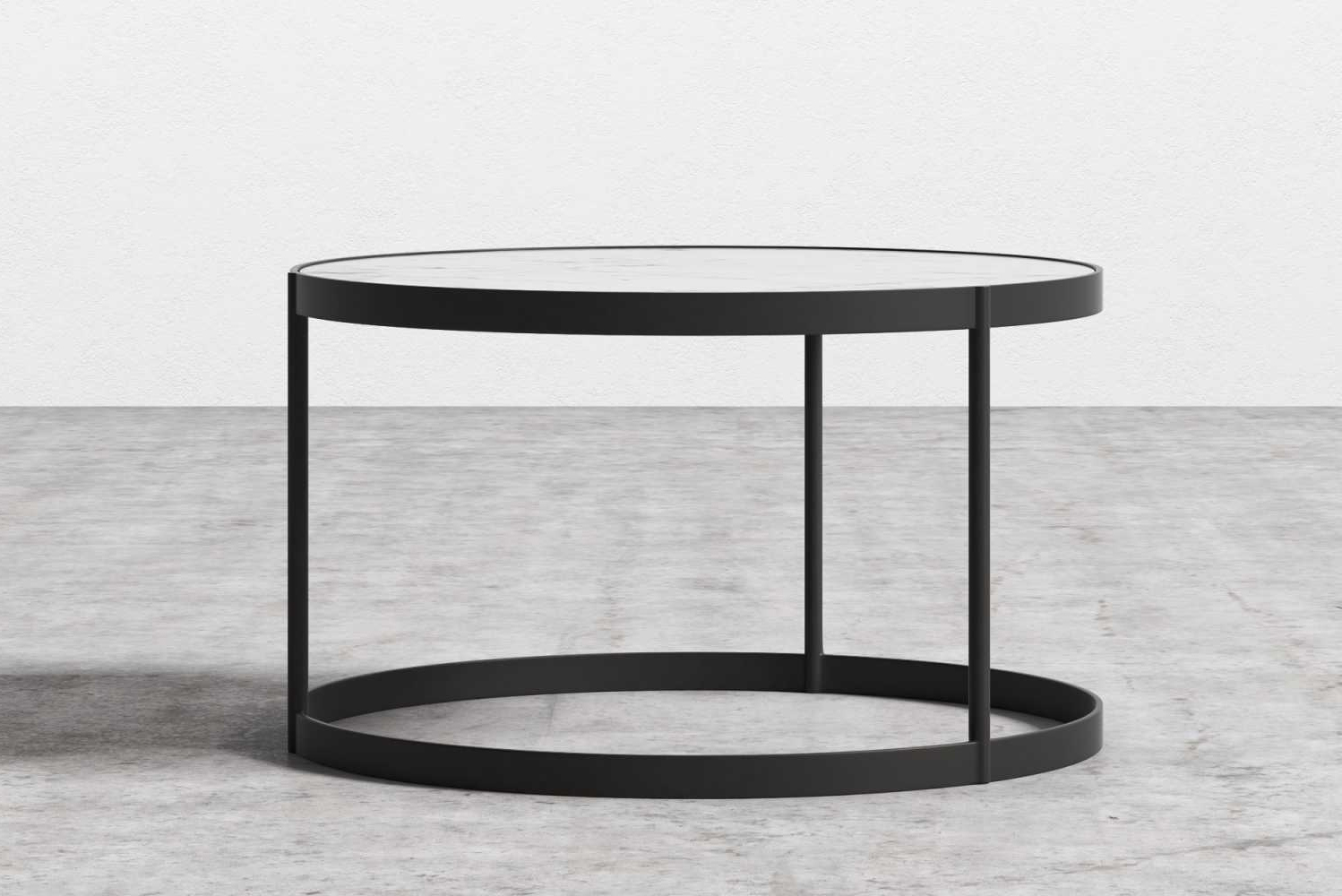The Malin coffee table has a smooth marble surface and a matte black metal base.