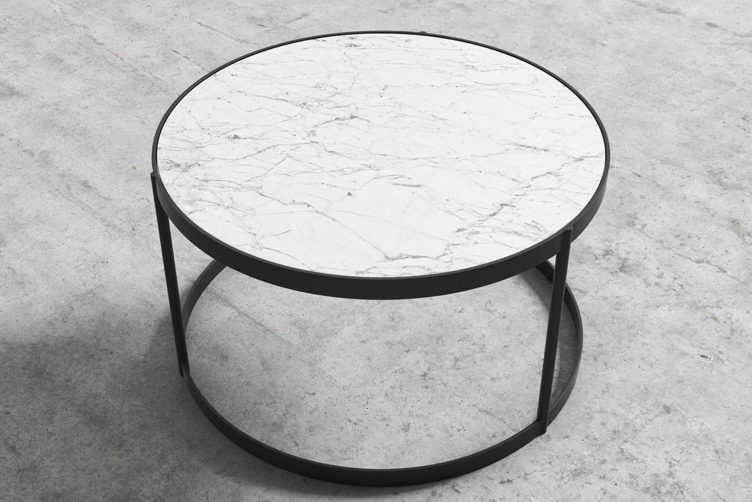 The table has three slim legs, removing clutter from the base and providing geometric stability and modern appeal.