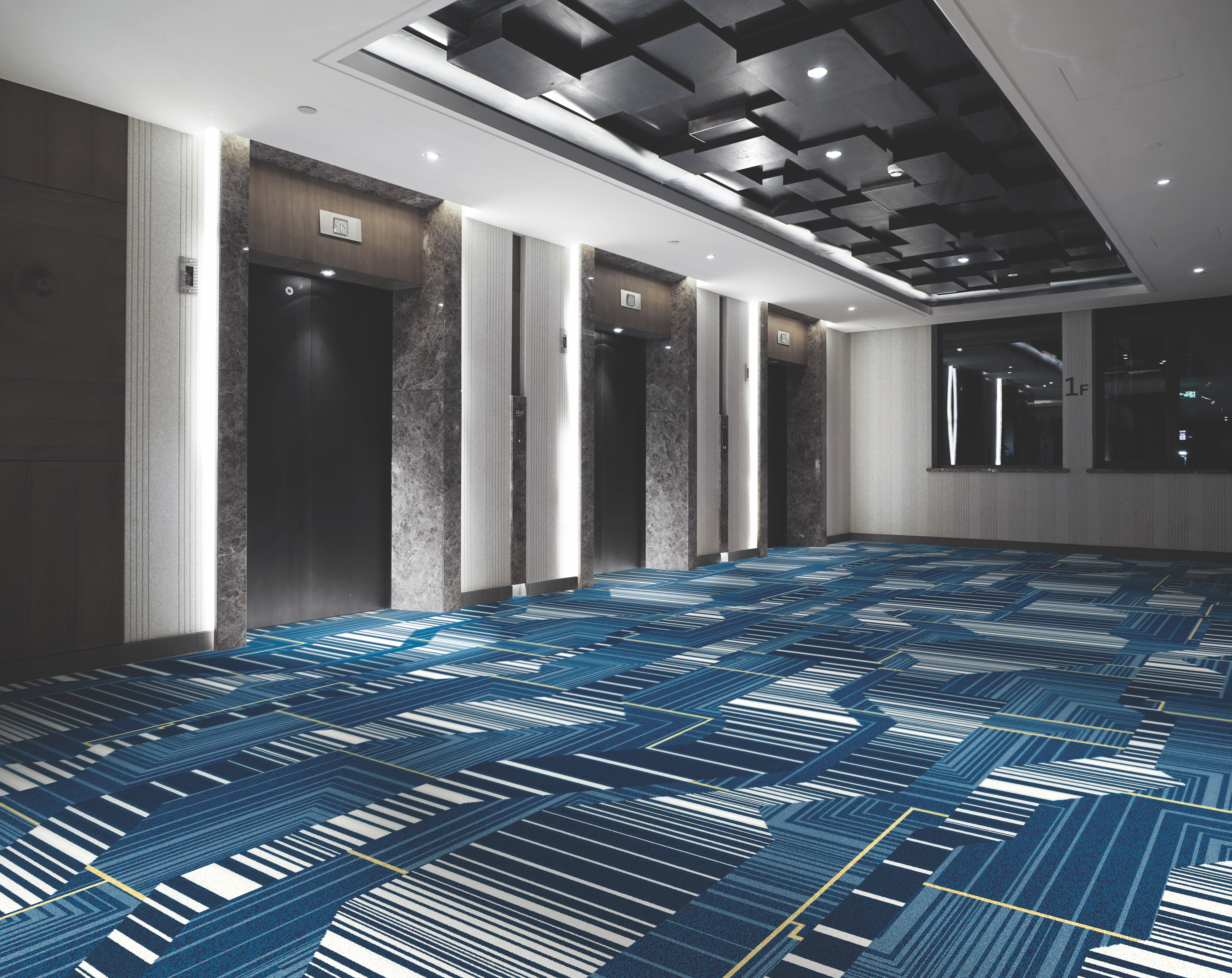 """Corridors make a design statement tied to what the owner or hotel designer is trying to achieve,"" said Paul Cleary, president hospitality, Tarkett North America. ""Select-service or focused-service tends to have wall-to-wall design solutions, whereas more upscale spaces will often have a design feature tied to the guestroom—either through the use of 'fit to design' patterns, or more simply, borders or border box areas containing complementary designs to the room."""