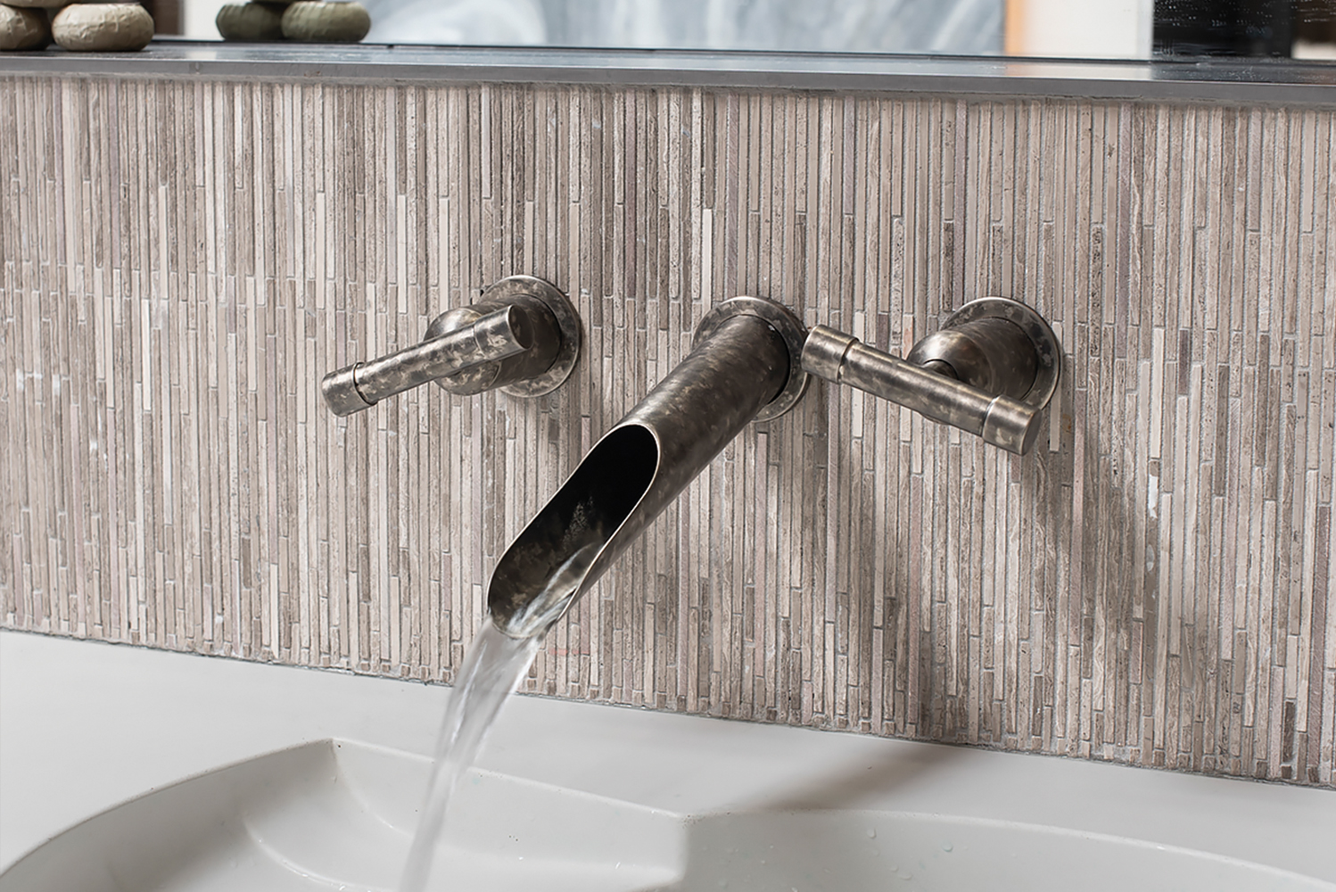 The faucets have independent controls that allow for flexibility for deck- or wall-mount installation wherever designers wish.