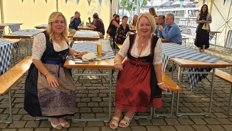 AmaMagna guests, Belkyes Colter and Candie Steinman, dressed in traditional Bavarian clothing for AmaWaterways' exclusive shoreside event.