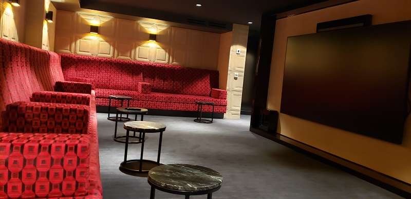 The theater on AmaMagna has a humongous screen and soft couch seating.