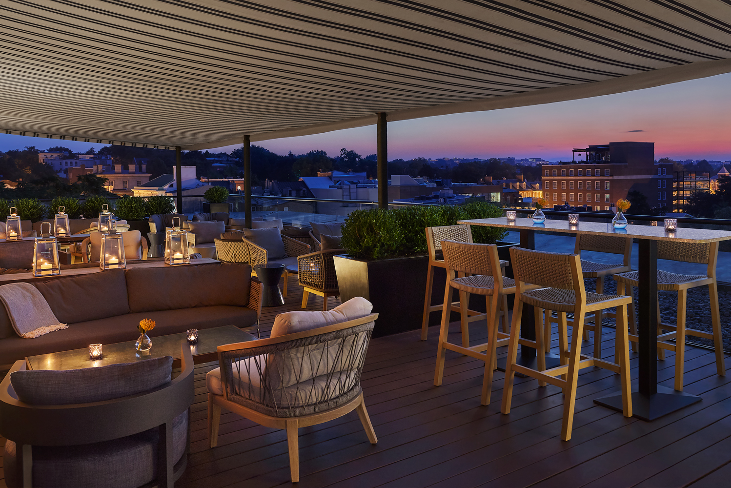 Set against the capital city's skyline, the hotel's new rooftop bar and lounge, CUT Above, offers al fresco entertaining. The open-air space is outfitted with modern lounge furniture.