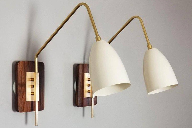 Blending Scandinavian, Danish and Italian modernism, Elska takes form against a walnut back plate with distinct, brass fittings.