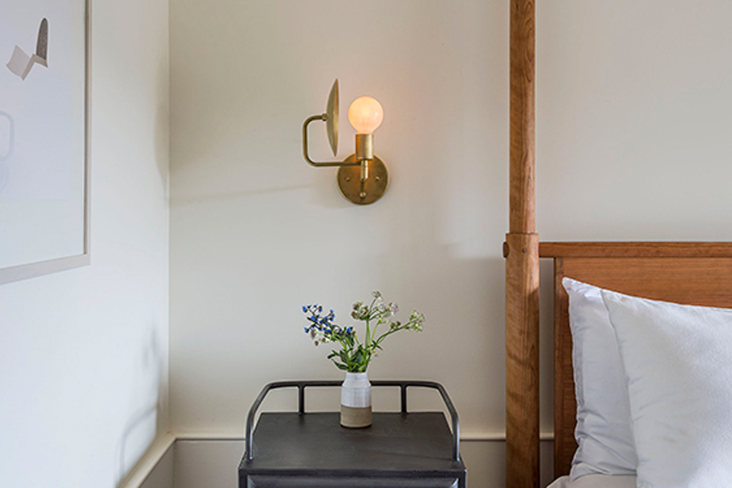 The sconce is a modern interpretation of an early American candle form.
