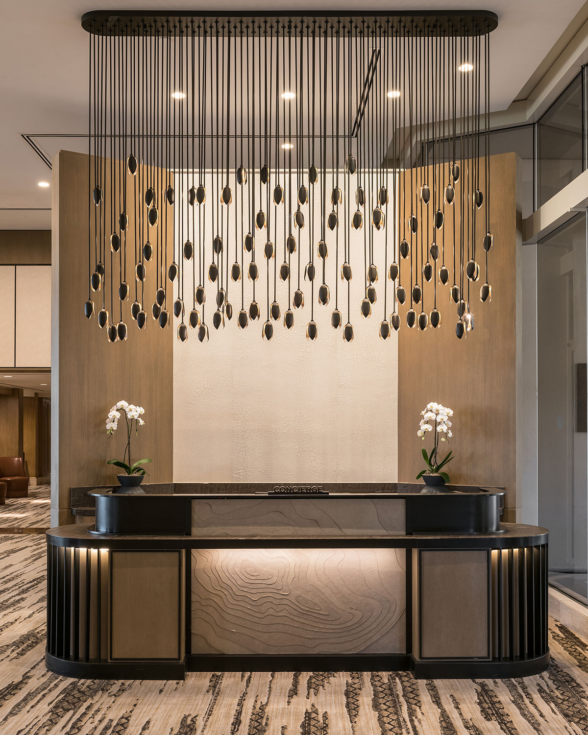 The chandelier over the concierge desk was inspired by the seed pods of the agave plant.