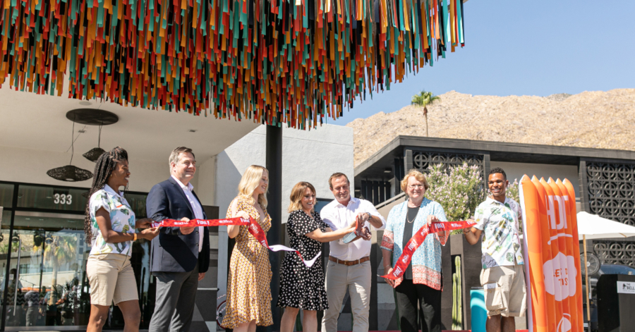 Jennifer Arnoldt, Taco Bell's senior director of retail engagement and experience, cuts a ceremonial ribbon made of hot sauce packets.