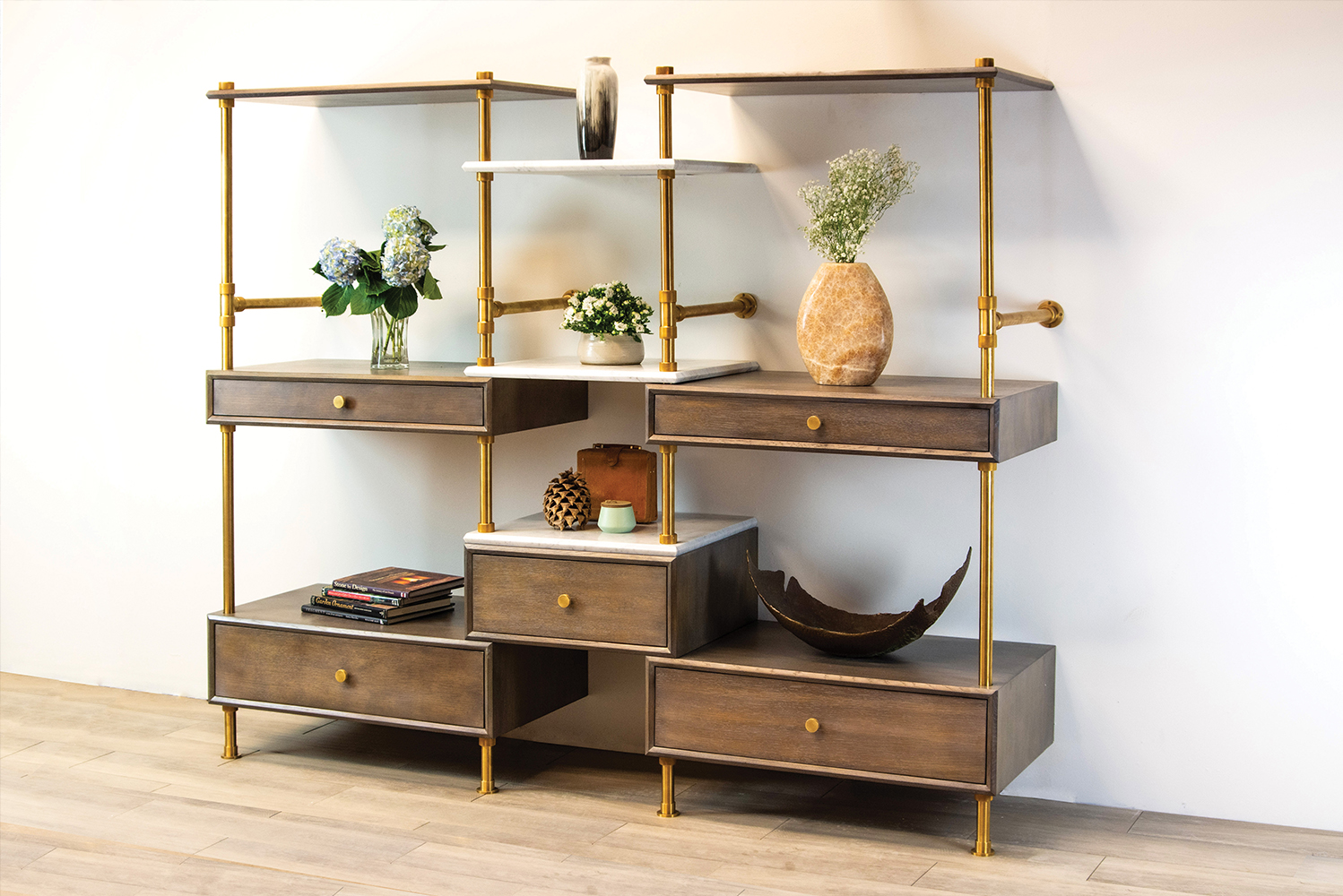 Stone Forest introduced its first furniture piece, the Elemental storage wall etagere.