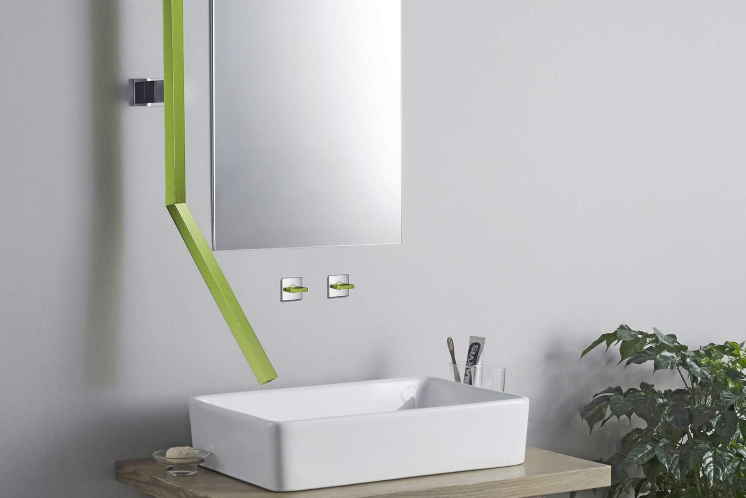 This faucet frames the side of the mirror before angling away from the wall to create a waterfall effect.