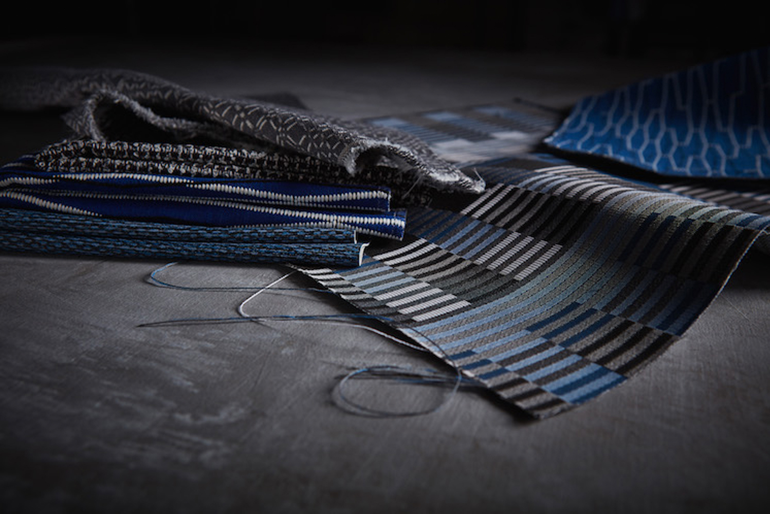 Providing a new spin on conventional plaids, the collection is available in a range of dark colors and patterns that can be mixed and matched.