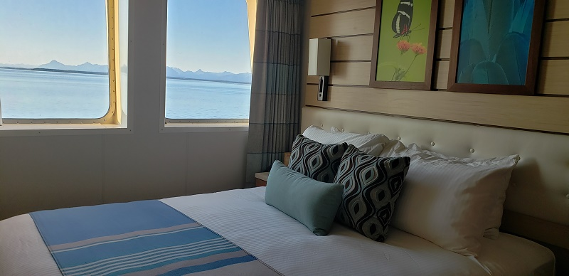 Bedroom area with two windows, providing good views of the Alaskan scenery.