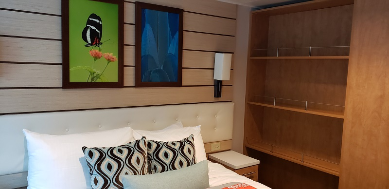 Bedroom area with large open shelving storage.