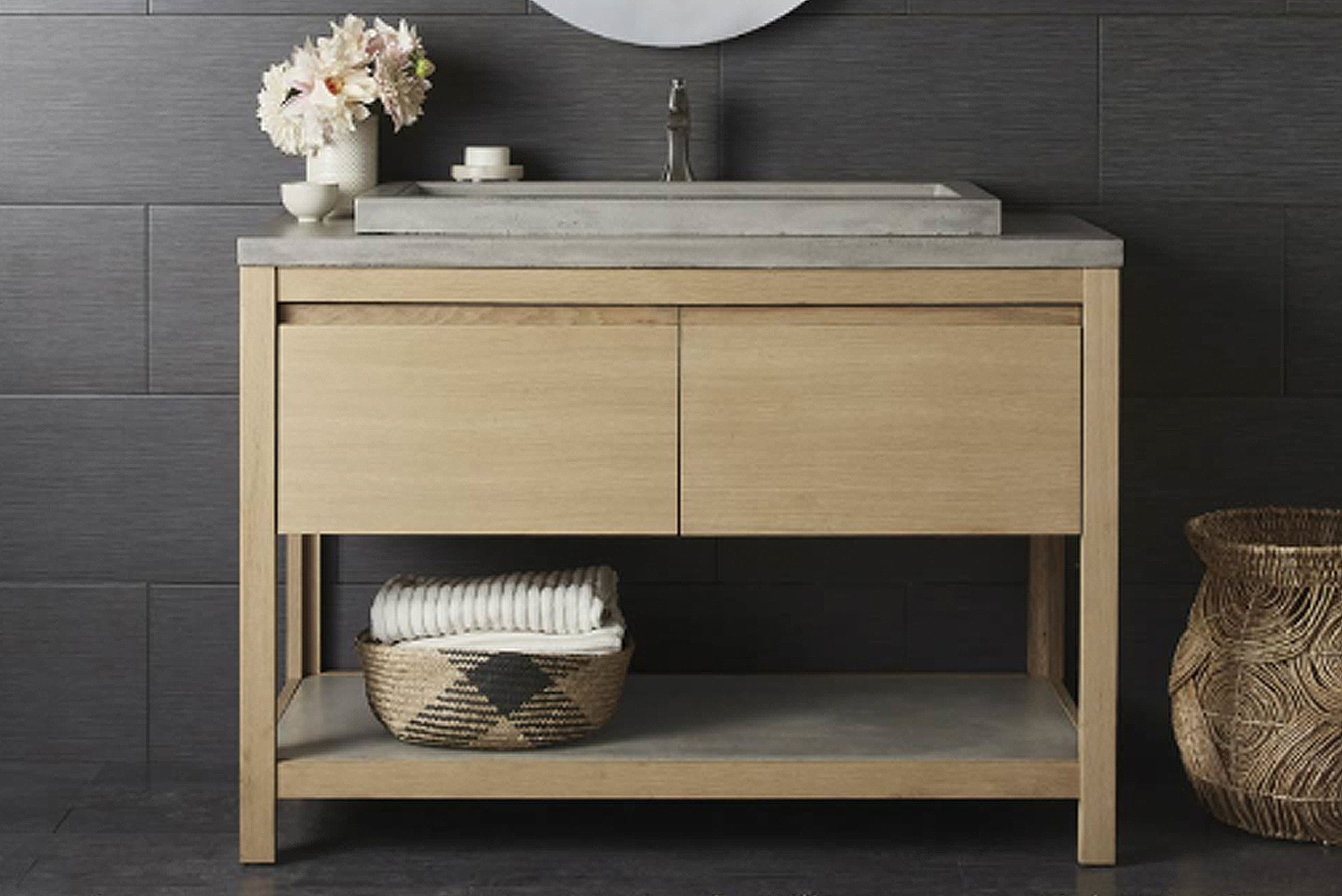The Solace vanity features solid oak paired with NativeStone to create a transitional bathroom centerpiece.