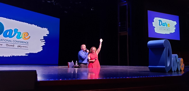 """Drew Daly and Debbie Fiorino """"rise"""" from beneath the stage."""