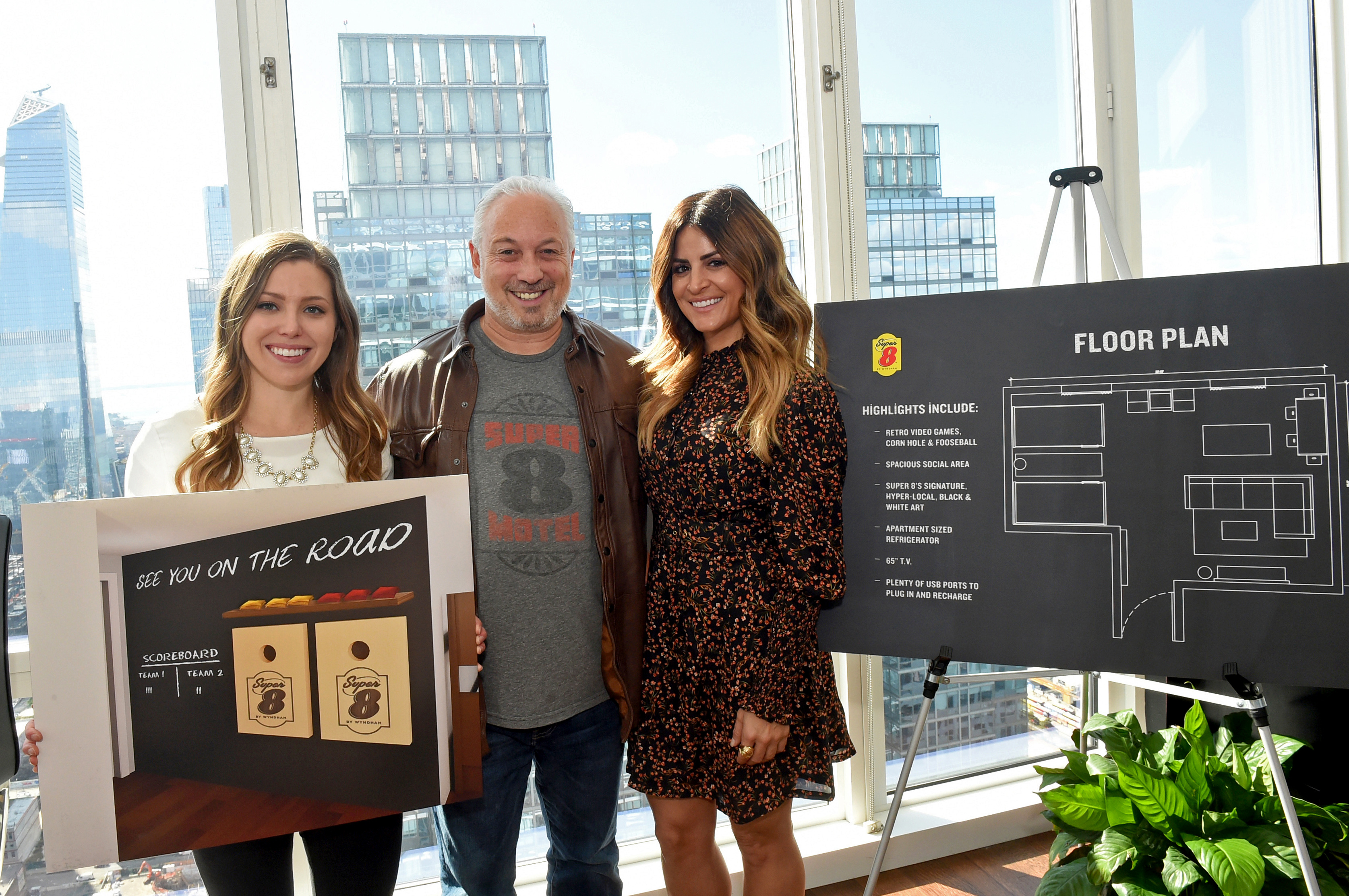 From left: Candice Buttars, undergrad design student at Utah State University and winner of the Room8 Design Challenge; Mike Mueller, Super 8 brand president; and Alison Victoria, celebrity interior designer and TV personality, show the floor plan of the new Super 8 by Wyndham Room8 design.