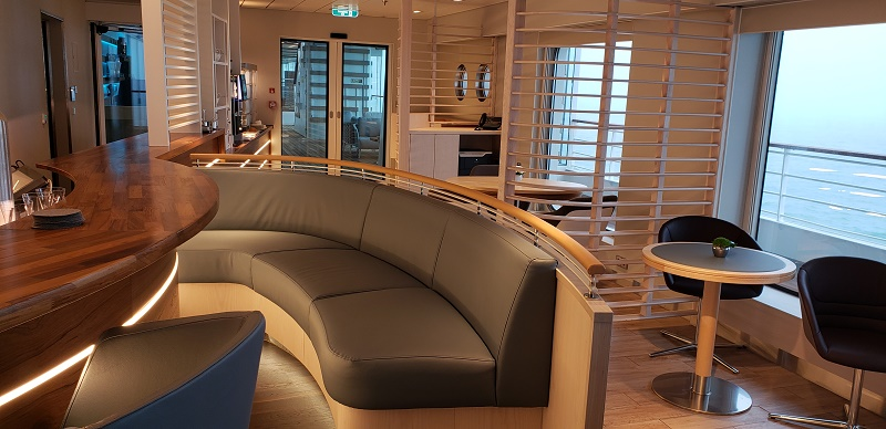 The Observation Lounge's seating with a coffee/tea bar area in the background.