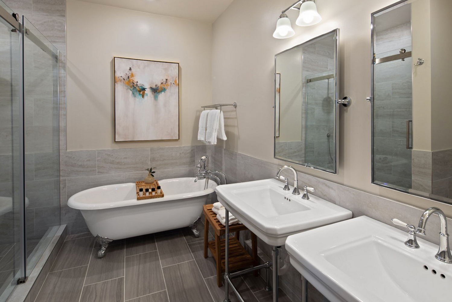 Keeping to the same color palette as the lobby, the rooms have 10-foot ceilings, plantation shutters, bathrooms with walk-in showers and makeup mirrors.