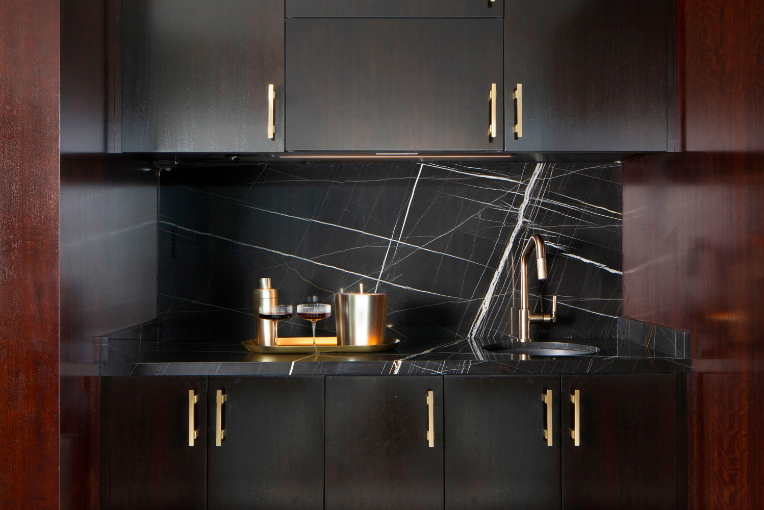 Details that highlight the suite's residential inspiration include a Nero Marquina marble countertop and fireplace.