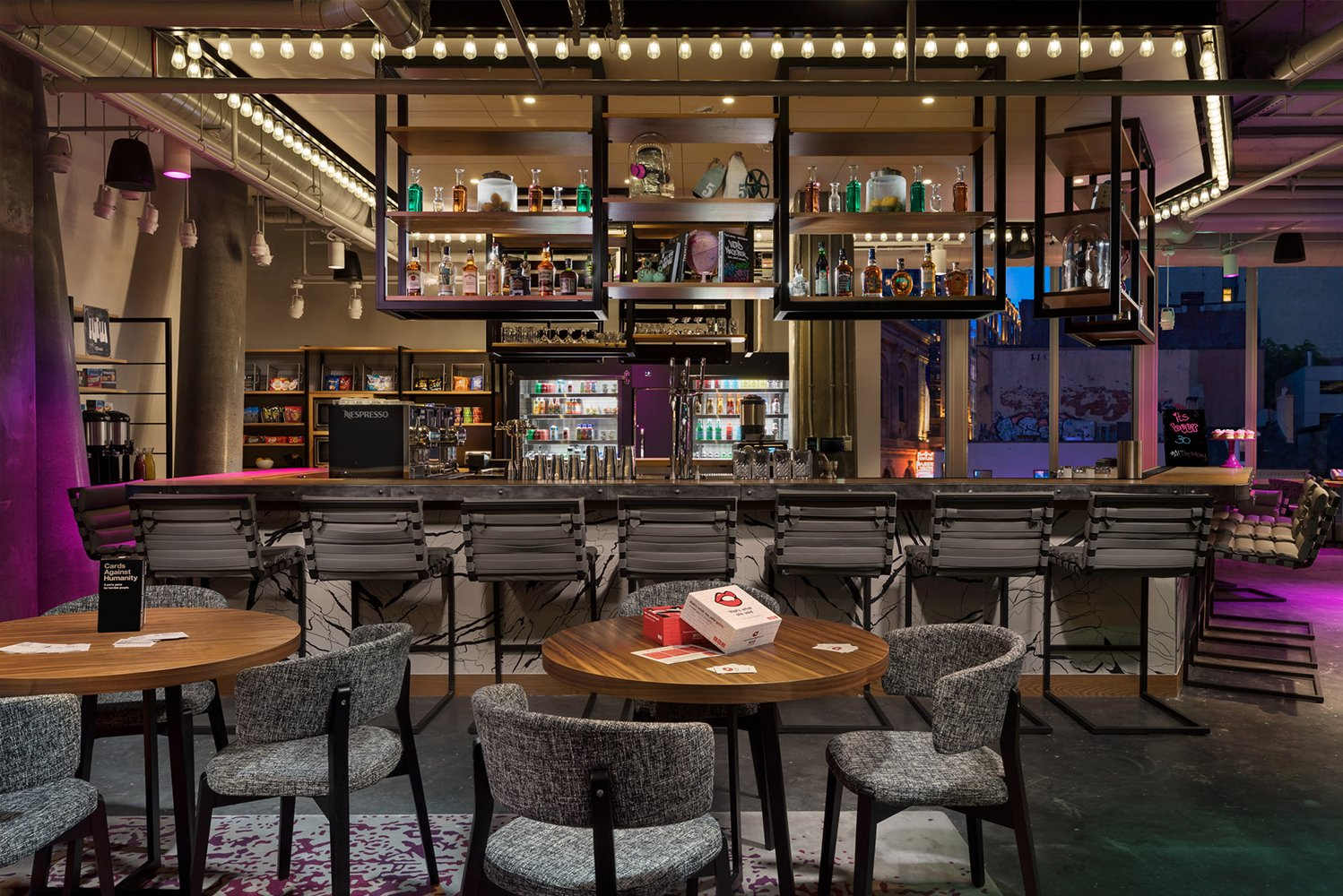 Designed by Boston's Group One, Moxy Boston Downtown's industrial chic design pays homage to the surrounding Theater District.