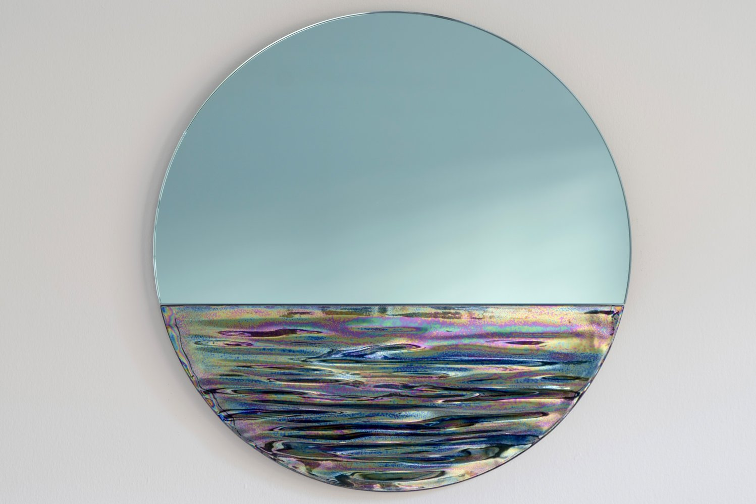 Part wall art, part functional decoration, the new mirrors were inspired by the horizon view of Lake Como in the north of Milan, Italy and Lake Michigan in Chicago.