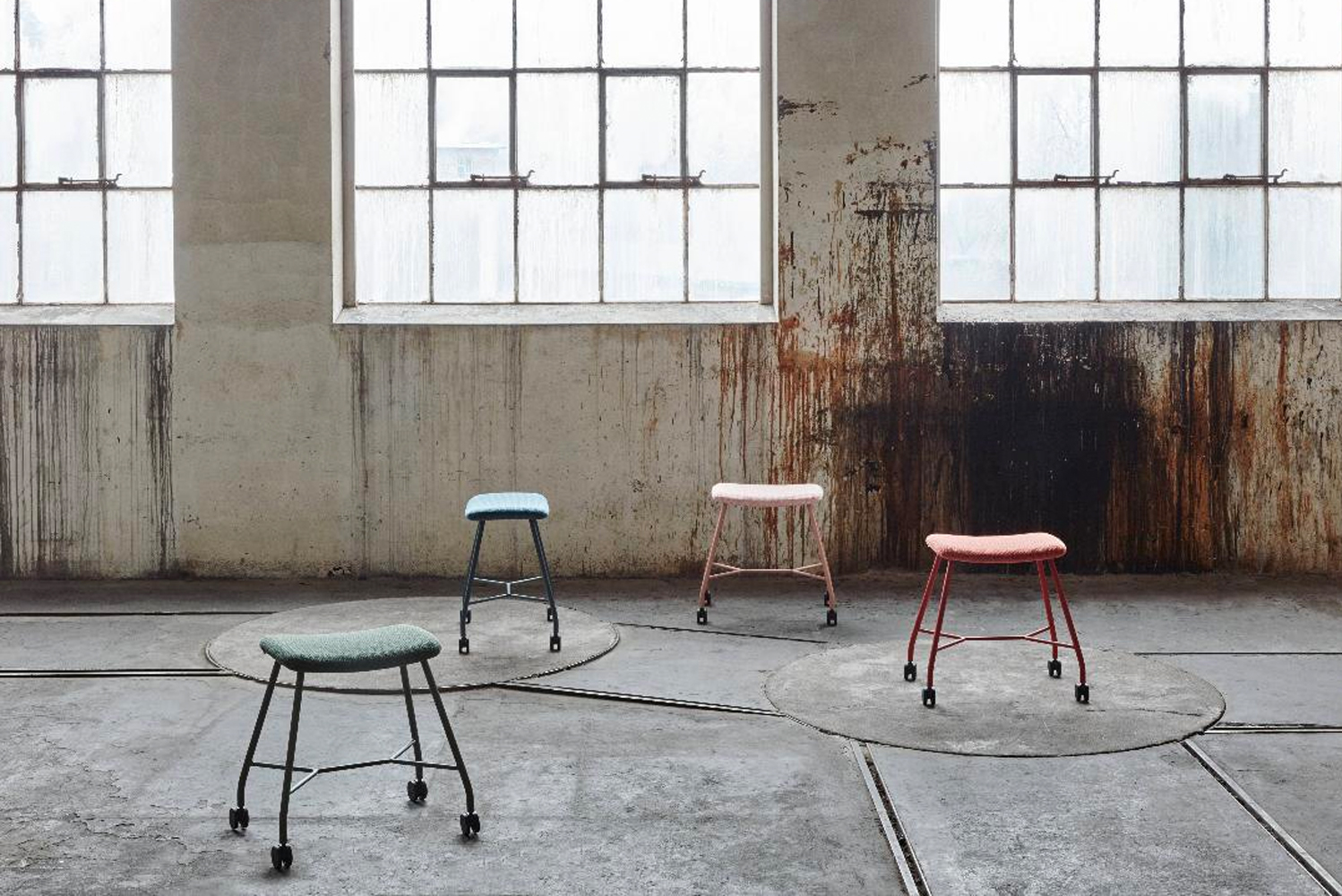 The stool is fitted with interval break castors for mobility.  Offered at two different heights, the Motus stool comes in chrome as well as the same fresh colorways as the Vagabond table.