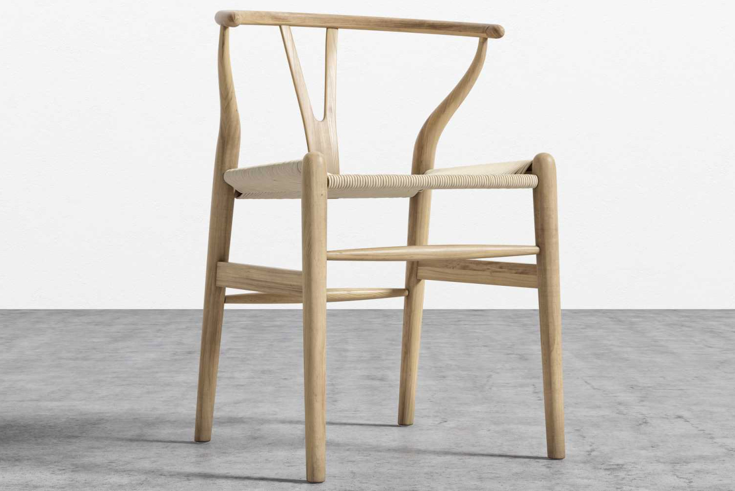 As offered by Rove Concepts, the chair has fluid lines and minimalist style that create an airy feel while the Y-back creates an organic impression.