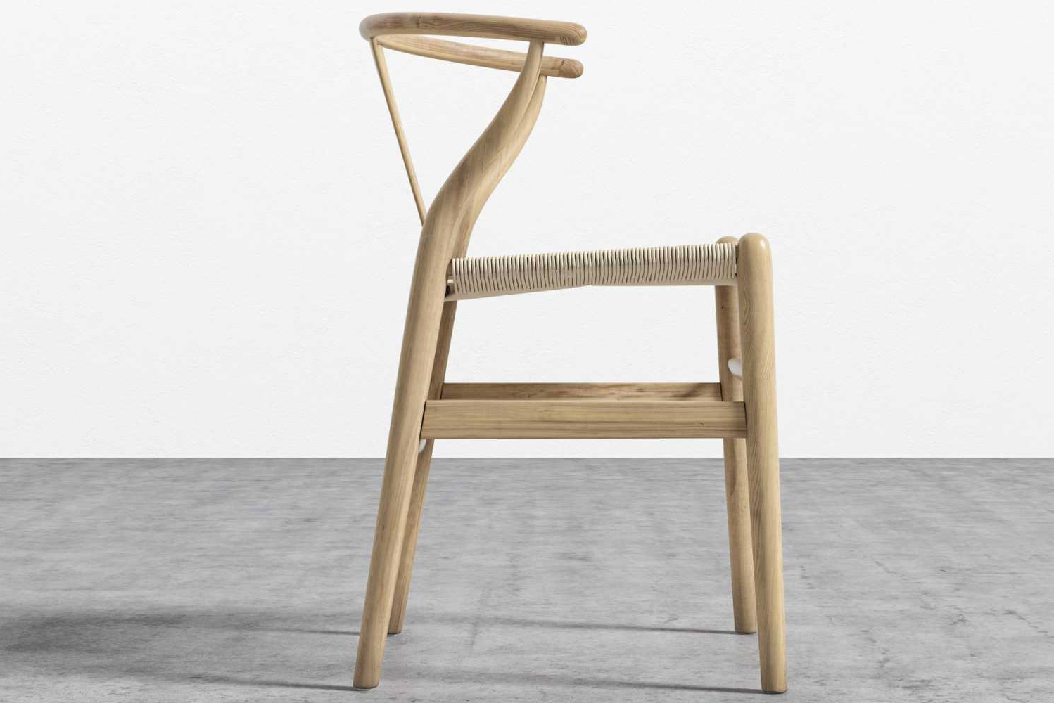 The chair has a curving top rail and tapered legs, as well as flexible yet sturdy woven seat.