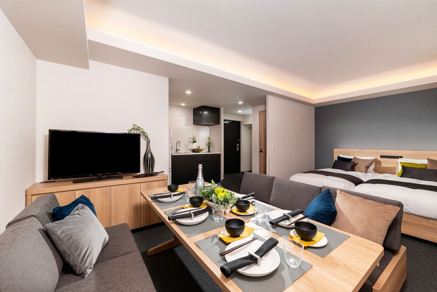 The design of the property is dominated by dark blue and dark wood.