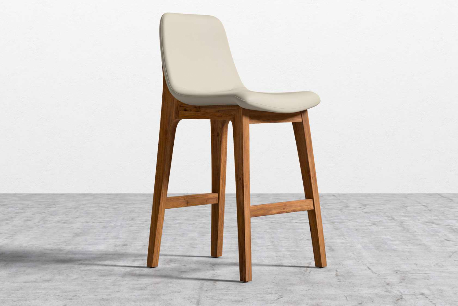 Made with vegan leather and solid ash wood in a walnut finish, the Aubrey counter stool is eco-friendly.