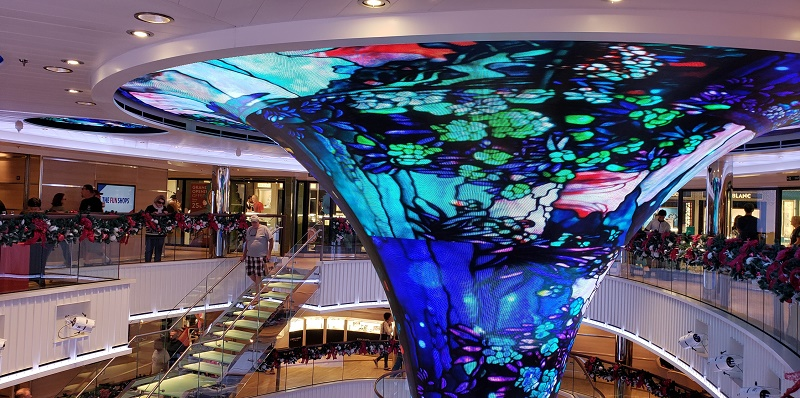 The atrium's artistic centerpiece is green one moment, blue or another color the next. Photo by Susan J. Young
