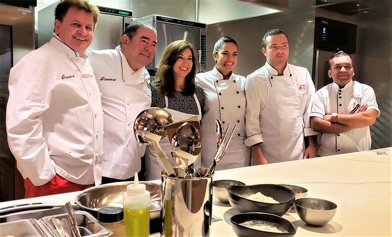 L to R, top chefs Rudi Sodamin and Emeril Lagasse; Christine Duffy, president, Carnival Cruise Line; Juliana Barrera, junior sous chef; Camilo Gonzales, chef de partie; and Jivas Raveendran, sous chef. Photo by Susan J. Young