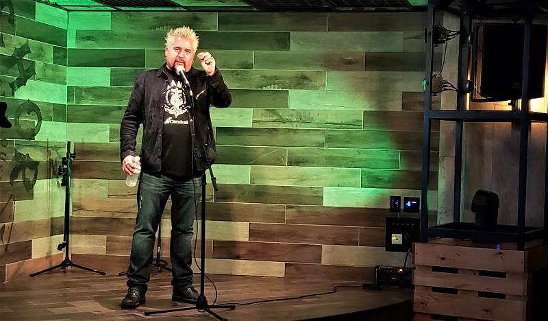 Chef Guy Fieri addresses reporters at a culinary event inside Guy's Pig & Anchor Smokehouse. Photo by Susan J. Young