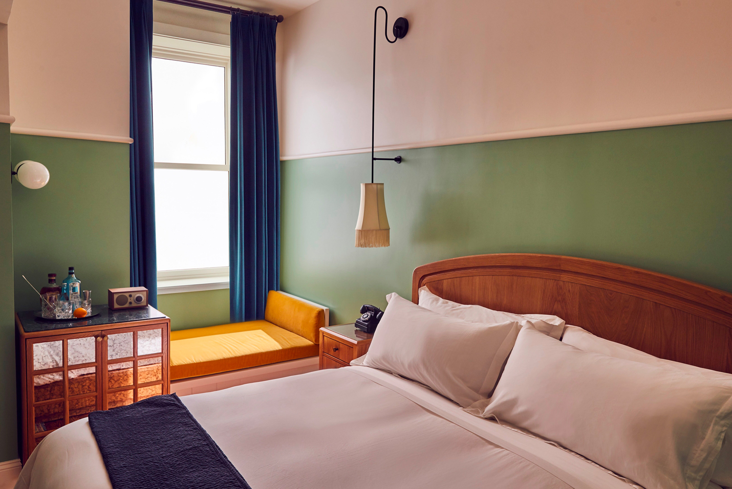 The rooms have residential feel, using shades of green and eggplant.