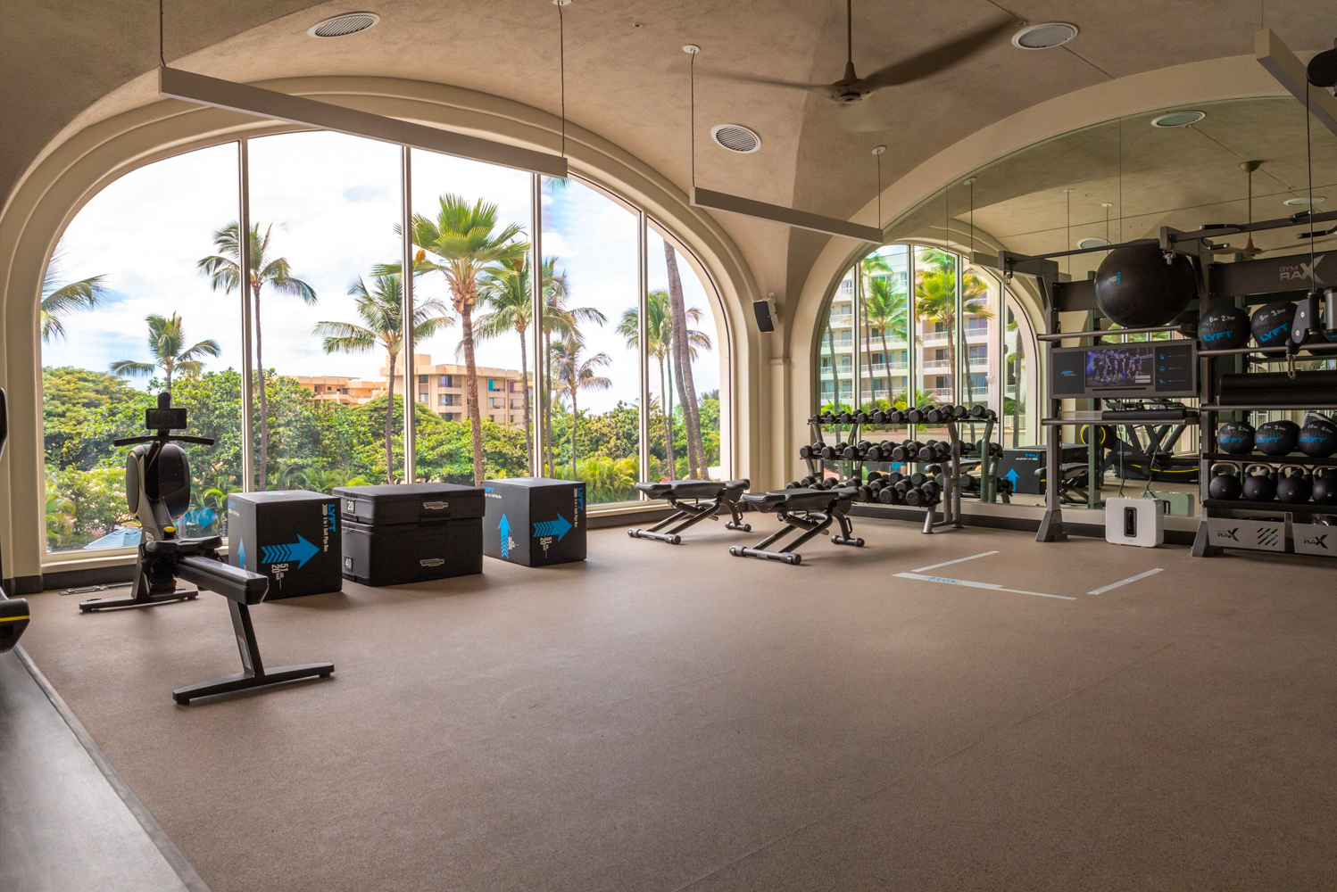 The brand new fitness center has an expansive workout space with floor-to-ceiling windows and panoramic views extending from the iconic architecture to the Pacific Ocean.