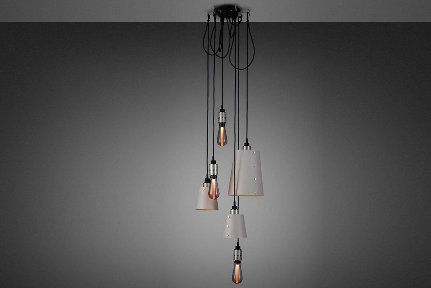 The drop length can be adjusted manually and hooked onto a solid metal hook, allowing the lights to be customized into any unique sculptural shape.