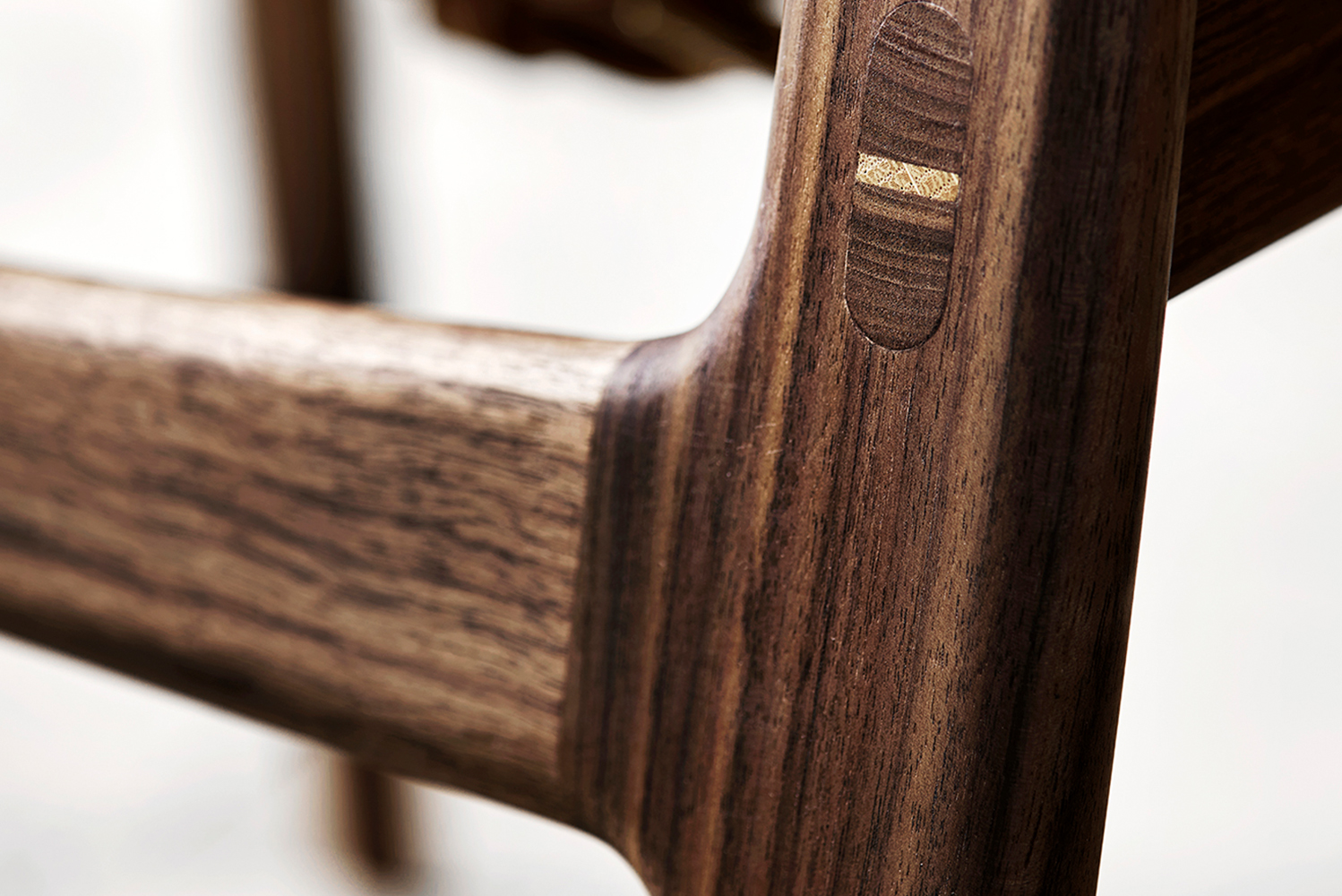 Huntsman chair is crafted in solid oak and walnut with various finishes.