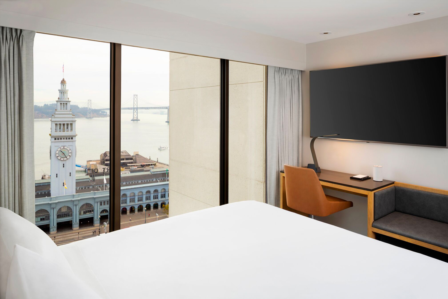 Designed by Looney & Associates, these new guestrooms have panoramic views of the San Francisco – Oakland Bay Bridge, historic Ferry Building and Treasure Island.