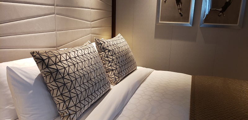 Luxurious bedding and soft colors in Sky Suite. Photo by Susan J. Young