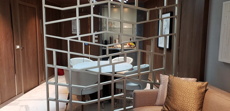 Sky Suite with view from living area to dining area, separated by a lattice-work panel. Photo by Susan J. Young