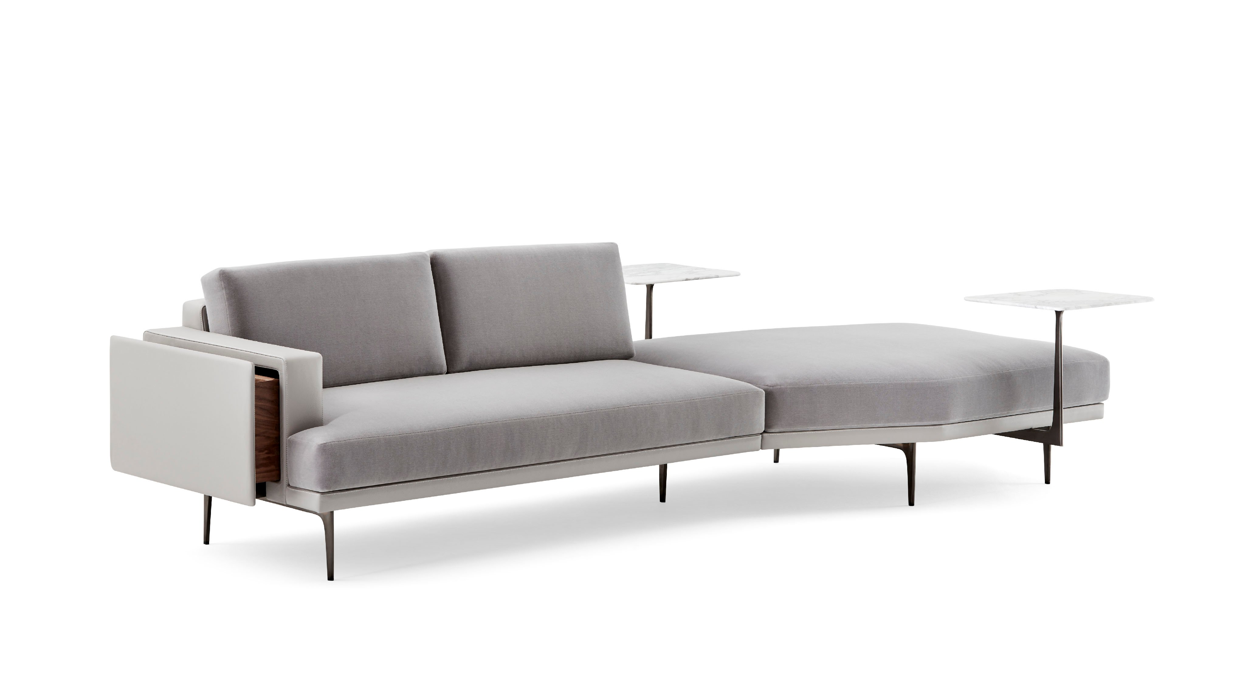 The Lyda sofa, designed for Haworth, has steel arms and a marble tablet surface.
