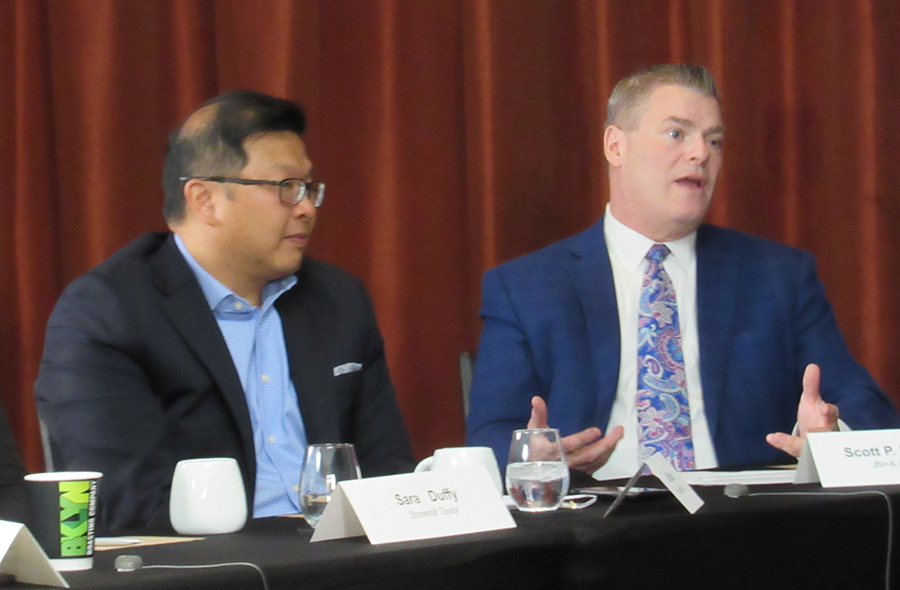 Jefferson Lam, VP, Loews Hotels & Co. [left], considers what Scott P. Rosenberg, president, Jonathan Nehmer & Associates and principal, HVS Design, is saying.