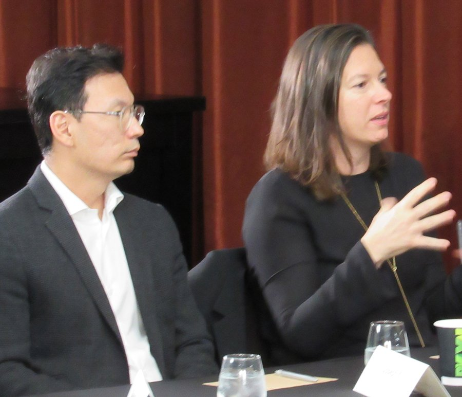 Real Hospitality Group's chief investment officer, Joseph Yi, listens as Sara Duffy, Stonehill Taylor's senior interiors associate, makes a point.