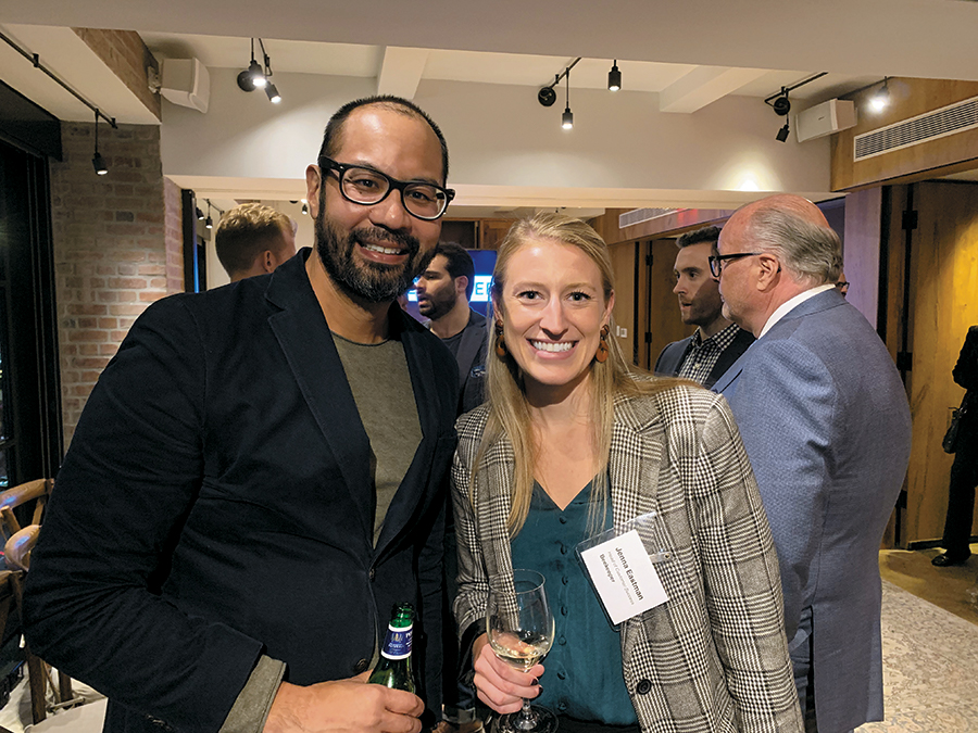 """Jeff David, founder of Jeff David Hospitality, and Jenna Eastman, head of customer service at Beekeeper, are all smiles during """"happy hour"""" socializing."""